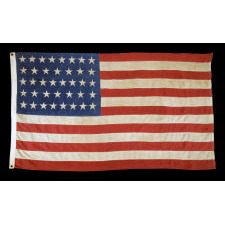 UNUSUAL ANTIQUE AMERICAN FLAG WITH 38 STARS ON A PAINT-PRINTED CANTON, ADJOINED TO 13 PIECED-AND-SEWN STRIPES, 1876-1889, COLORADO STATEHOOD