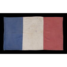REMARKABLE FRENCH FLAG WITH AMERICAN SALUTATIONS, WAVED AND SIGNED BY MEMBERS OF THE HENRY FAMILY IN THANKFUL CELEBRATION OF THEIR LIBERATION FROM THE NAZIS DURING WWII, 1944-45
