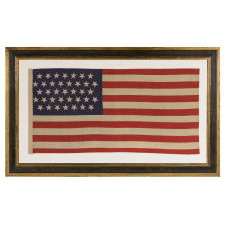 "37 STARS IN A ""DANCING"" OR ""TUMBLING"" ORIENTATION ON AN ANTIQUE AMERICAN FLAG WITH ELONGATED PROPORTIONS, NEBRASKA STATEHOOD, 1867-1876, THE ERA OF AMERICAN RECONSTRUCTION"