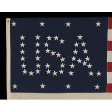 "48 STARS CONFIGURED INTO THE LETTERS ""U.S.A."", COPYRIGHTED IN 1916 BY C.A. HARTMAN, ONE OF ONLY FOUR KNOWN SURVIVING EXAMPLES AND ONE OF THE MOST INTERESTING DESIGNS KNOWN TO EXIST IN EARLY FLAGS"