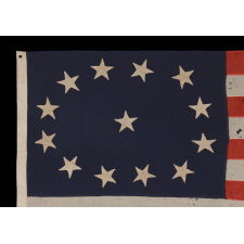 13 HAND-SEWN STARS, IN AN OVAL VERSION OF THE 3RD MARYLAND PATTERN, ON AN ANTIQUE AMERICAN FLAG MADE IN THE PERIOD BETWEEN THE CIVIL WAR (1861-65) AND THE 1876 CENTENIAL OF AMERICAN INDEPENDENCE