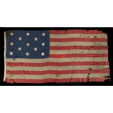 "13 HAND-SEWN STARS IN A 3-2-3-2-3 CONFIGURATION OF LINEAL ROWS, ON A LARGE SCALE ANTIQUE AMERICAN FLAG WITH A STENCILED SIGNATURE ALONG THE HOIST THAT READS ""GEO L. WRIGHT. BOYLSTON. MA."", PROBABLY MADE FOR THE 100-YEAR ANNIVERSARY OF AMERICAN INDEPENDENCE IN 1876"