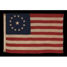 13 STARS IN A CIRCULAR VERSION OF THE 3RD MARYLAND PATTERN, ON AN ESPECIALLY ATTRACTIVE, SMALL SCALE, ANTIQUE AMERICAN FLAG, MADE IN THE 1890-1910 ERA