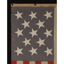 ENTIRELY HAND-SEWN, 13 STAR, U.S. NAVY SMALL BOAT ENSIGN WITH A DUSTY BLUE CANTON, SIGNED AND DATED, 1889