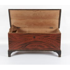 YORK COUNTY, PENNSYLVANIA BLANKET CHEST WITH RED AND BLACK STYLIZED DECORATION ON BLACK FEET, ca 1835