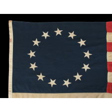 13 STARS IN THE BETSY ROSS PATTERN, MADE BY ANNIN IN NEW YORK CITY, A SCARCE SEWN EXAMPLE IN A DESIRABLE SMALL SCALE, 1914-1930