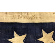 35 HAND-SEWN, SINGLE-APPLIQUÉD STARS ON A CIVIL WAR FLAG FLOWN BY A NEW YORK STATE TINSMITH, MADE BETWEEN 1863 - 1865, REFELECTS WEST VIRGINIA STATEHOOD