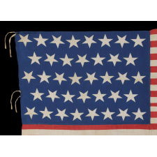 38 STARS AND A VERY UNUSUAL COMPLEMENT OF 31 STRIPES, ON AN ANTIQUE AMERICAN FLAG MADE DURING THE PERIOD WHEN COLORADO WAS THE MOST RECENT STATE TO JOIN THE UNION, 1876-1889, WITH STUNNING GRAPHICS AND COLORS, ONE-OF-A-KIND AMONG KNOWN EXAMPLES