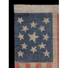 13 STARS IN A MEDALLION PATTERN ON AN ANTIQUE AMERICAN PARADE FLAG, MADE FOR THE 1876 CENTENNIAL OF AMERICAN INDEPENDENCE; A LARGE EXAMPLE AMONG ITS COUNTERPARTS OF THE PERIOD
