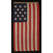 13 STAR U.S. NAVY SMALL BOAT ENSIGN MADE AT THE BROOKLYN NAVY YARD, NEW YORK, DATED 1907, PROBABLY PRODUCED TO OUTFIT TEDDY ROOSEVELT'S GREAT WHITE FLEET