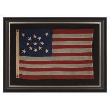 """13 STARS IN A MEDALLION CONFIGURATION ON A SMALL-SCALE ANTIQUE AMERICAN FLAG OF THE 1895-1926 ERA, SIGNED """"TAUTOG,"""" PROBABLY FLOWN ON THE YACHT OF THAT NAME BY OWNER GEORGE GARDINER FRY, WHO WON MANY RACES WITH HER AT THE TURN-OF-THE-CENTURY"""