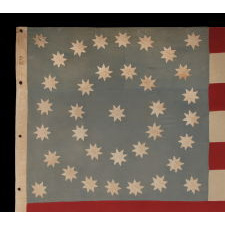 "36 EIGHT-POINTED STARS IN MEDALLION CONFIGURATION, ON AN OCEAN BLUE CANTON THAT RESTS ON THE WAR STRIPE; A SPECTACULAR CIVIL WAR PERIOD FLAG FROM THE TINCLAD GUNBOAT ""GENERAL GRANT,"" THAT SERVED ON THE TENNESSEE RIVER IN DEFENSE OF THE MISSISSIPPI"
