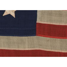 15 STARS IN A CIRCULAR MEDALLION WITH A SQUARE OF STARS IN THE CENTER, A UNIQUE FLAG WITH A RARE STAR COUNT AND IN A DESIRABLE SMALL SCALE AMONG ITS COUNTERPARTS OF THE PERIOD; MADE CA 1842-1867