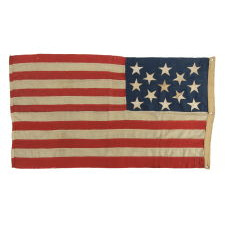 13 STARS ON A U.S. NAVY SMALL BOAT ENSIGN, ENTIRELY HAND-SEWN, PROBABLY MADE BETWEEN 1882 AND 1884, A BEAUTIFUL EXAMPLE IN A REMARKABLE STATE OF PRESERVATION