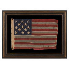 13 HAND-SEWN STARS IN A 3-2-3-2-3 PATTERN ON AN ANTIQUE AMERICAN FLAG WITH ENDEARING WEAR FROM LONG-TERM USE, PROBABLY MADE DURING THE AMERICAN CIVIL WAR (1861-65), AND POSSIBLY ONCE BELONGING TO CIVIL WAR GENERAL AND SECRETARY OF THE NAVY BENJAMIN FRANKLIN TRACY