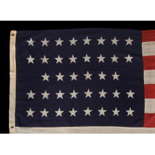 "38 STARS IN A ""NOTCHED"" PATTERN ON A 7 ft. CLAMP-DYED AMERICAN FLAG OF THE 1876-1889 PERIOD, REFLECTS COLORADO STATEHOOD, MADE BY THE U.S. BUNTING COMPANY IN LOWELL, MASSACHUSETTS"