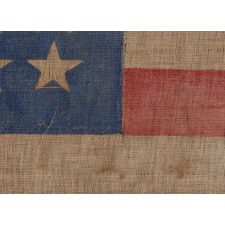 44 STAR ANTIQUE AMERICAN PARADE FLAG WITH A CORNFLOWER BLUE CANTON, ITS STARS ARRANGED IN A NOTCHED PATTERN, AND WITH A KEENLY ENDEARING PRESENTATION, 1890-1896, WYOMING STATEHOOD