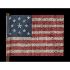 13 STARS IN A MEDALLION PATTERN ON AN ANTIQUE AMERICAN PARADE FLAG MADE FOR THE 1876 CENTENNIAL CELEBRATION