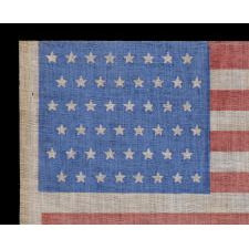 48 STARS IN STAGGERED ROWS ON AN ANTIQUE AMERICAN FLAG WITH A BRILLIANT, CORNFLOWER BLUE CANTON, MADE BETWEEN 1912 - 1918, OR PERHAPS PRIOR; REFLECTS ARIZONA & NEW MEXICO STATEHOOD