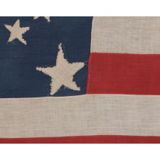 31 STARS IN A MEDALLION PATTERN ON AN ELONGATED, HOMEMADE FLAG WITH A VERTICALLY-ORIENTED CANTON AND EXCEPTIONAL FOLK QUALITIES, PRE-CIVIL WAR, CALIFORNIA STATEHOOD, 1850-1858