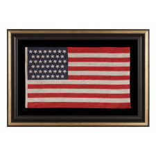 """45 STARS IN LINEAR ROWS, WITH """"DANCING"""" OR """"TUMBLING"""" ORIENTATION, ON AN ANTIQUE AMERICAN PARADE FLAG, 1896-1908, SPANISH-AMERICAN WAR ERA, REFLECTS UTAH STATEHOOD"""