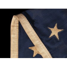 39 STARS ON AN ANTIQUE AMERICAN FLAG WITH HAND-SEWN, SINGLE-APPLIQUÉD STARS, MADE BY ANNIN IN NEW YORK CITY, DATING TO THE 1876 CENTENNIAL OF AMERICAN INDEPENDENCE, NEVER AN OFFICIAL STAR COUNT, REFLECTS THE ANTICIPATED ARRIVAL OF COLORADO AND THE DAKOTA TERRITORY