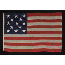 """13 STARS ARRANGED IN A 3-2-3-2-3 PATTERN ON A SMALL-SCALE ANTIQUE AMERICAN FLAG MARKED """"UNITED STATES ARMY STANDARD BUNTING"""", CA 1895 - 1910"""