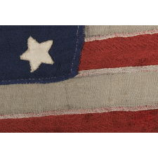34 STARS ON A HOMEMADE AND ENTIRELY HAND-SEWN FLAG OF THE CIVIL WAR PERIOD, THE SMALLEST I HAVE EVER ENCOUNTERED AMONG PIECED-AND-SEWN WOOL EXAMPLES, AN EXTRAORDINARY FIND, 1861-63, KANSAS STATEHOOD