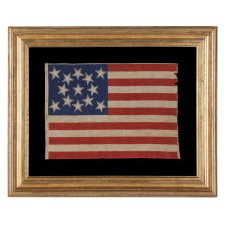 13 HALOED STARS IN A MEDALLION CONFIGURATION, ON AN EXCEPTIONALLY RARE ANTIQUE AMERICAN FLAG MADE FOR THE 1876 CENTENNIAL OF AMERICAN INDEPENDENCE