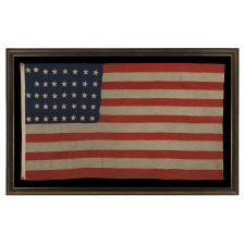 """38 HAND-SEWN STARS IN A """"NOTCHED"""" PATTERN ON AN ANTIQUE AMERICAN FLAG MADE AT THE TIME WHEN COLORADO WAS THE MOST RECENT STATE TO JOIN THE UNION, 1876-1889"""