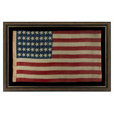 40 CANTED STARS IN AN ORDERLY PHALANX, ON AN ANTIQUE AMERICAN FLAG WITH A RARE STAR COUNT, ACCURATE FOR JUST SIX DAYS AND NEVER OFFICIAL, REFLECTING SOUTH DAKOTA'S ADMISSION TO THE UNION